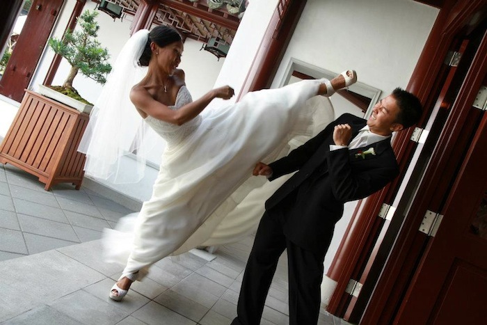 Bride kicking groom