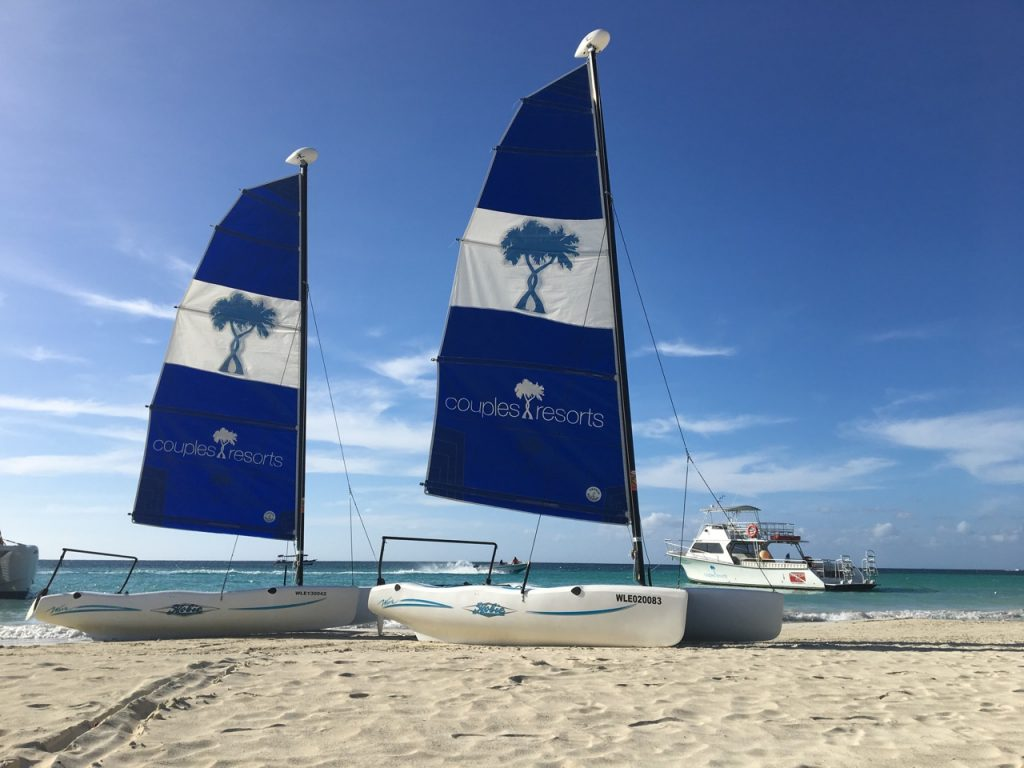 couples swept away negril, watersports, hobie cat
